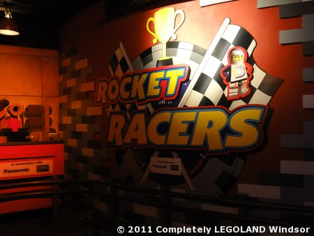 A large RR logo at the start of the queueline, next to a LEGO toolkit.